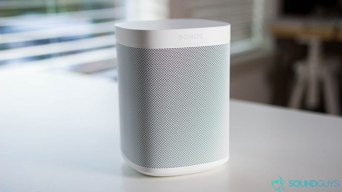 A Sonos One speaker on a table.
