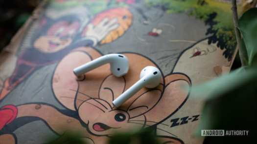 New AirPods laying on a comic book