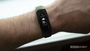 samsung galaxy fit fitness tracker on wrist weather screen