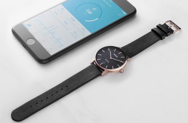 Nowa Shaper Hybrid Smart Watch next to smartphone