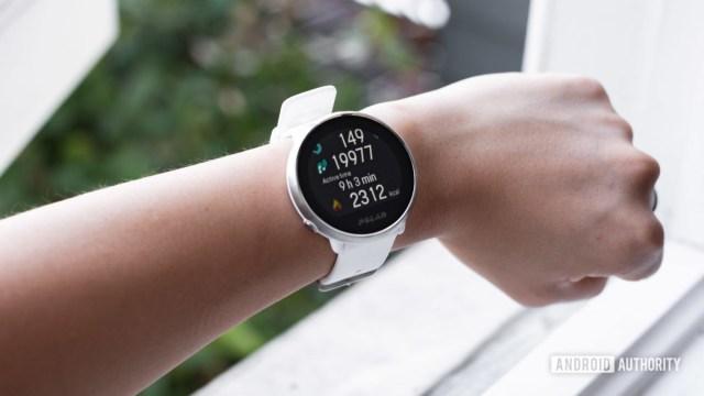 Polar Ignite smart fitness watch being worn on a female's left wrist.