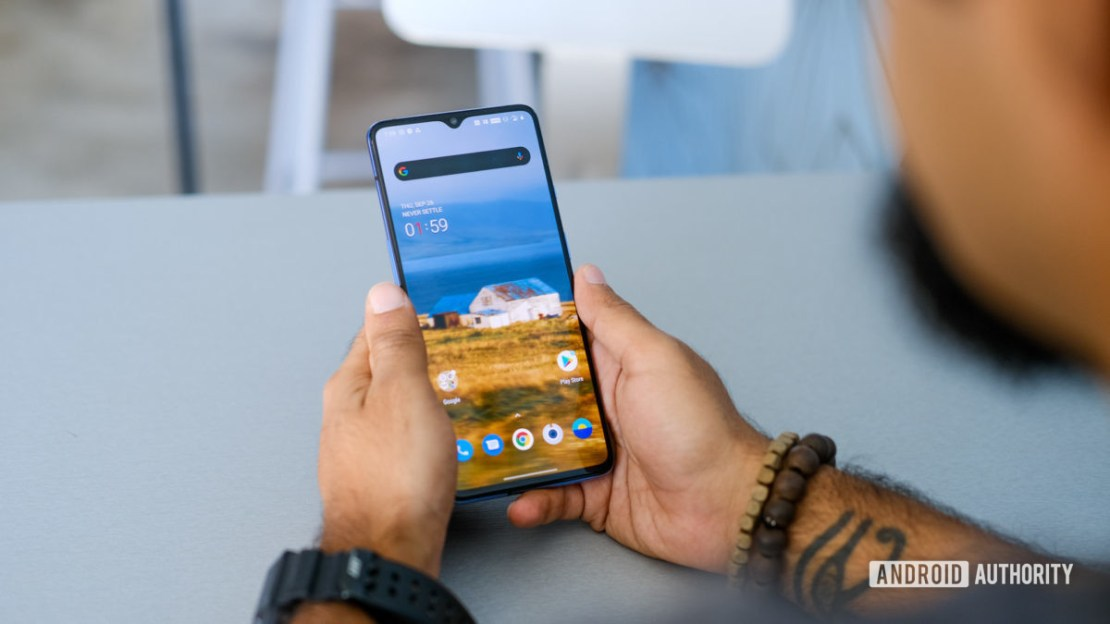 OnePlus 7T using in hand on table 2