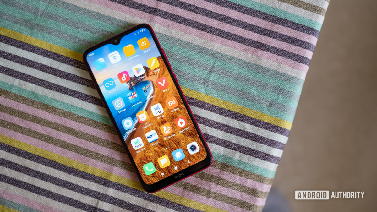 Redmi 8 on the table with display and notch