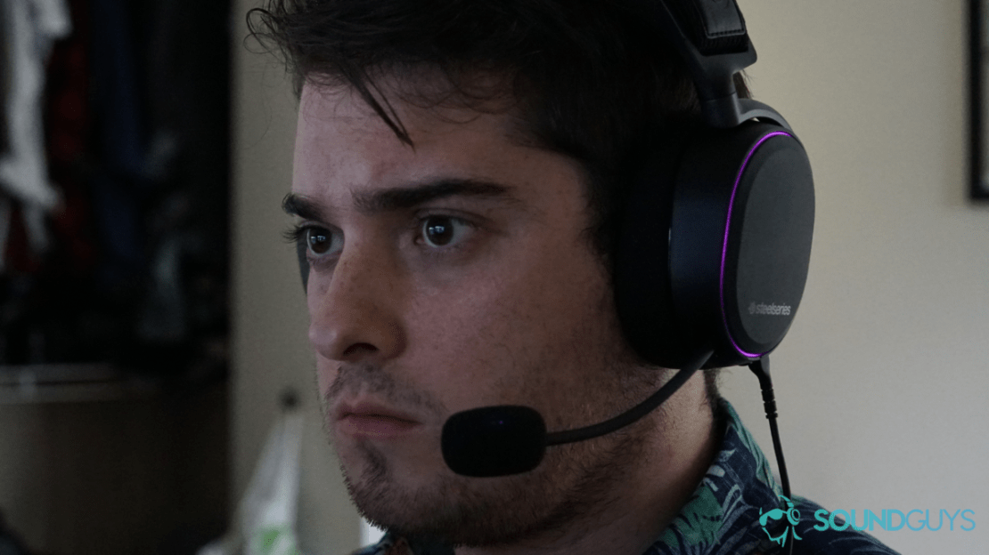 A man wears the SteelSeries Arctis Pro