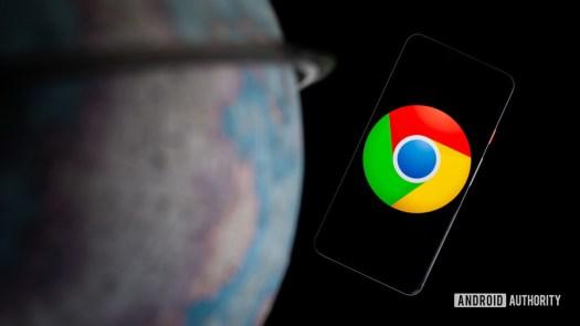 Google Chrome on smartphone next to globe stock photo
