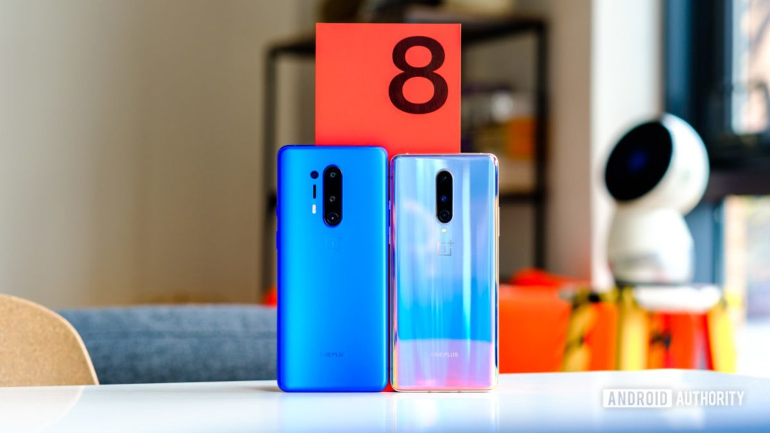 OnePlus 8 and 8 Pro in front of box