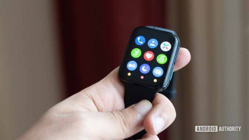Oppo Watch in hand showing apps