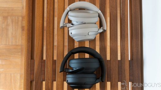 The Sony WH-1000XM3 and Sony WH-1000XM4 lay folded up on a wooden bench.