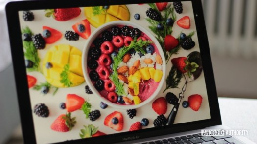 Apple MacBook Air M1 showing photos of fruits