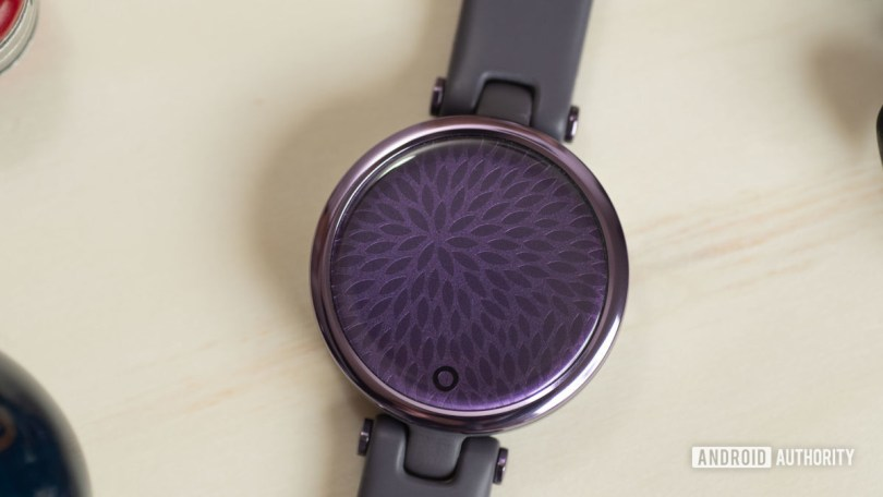 The blank face of the Garmin Lily Sport Edition smart watch in purple.