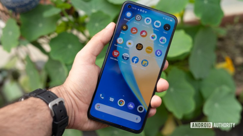 Realme X7 Pro 5G phone and display on in hand