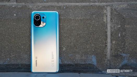Xiaomi Mi 11 back against brick