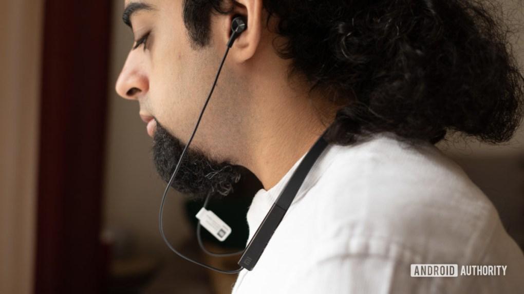 Mi Neckband Bluetooth Earphones around neck with earphones in ears