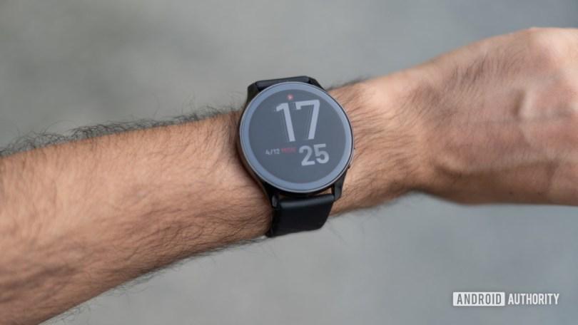 OnePlus Watch on wrist with watchface