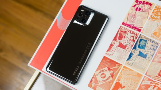 Oppo Find X3 Pro 5G reflective back on a coffee table book.