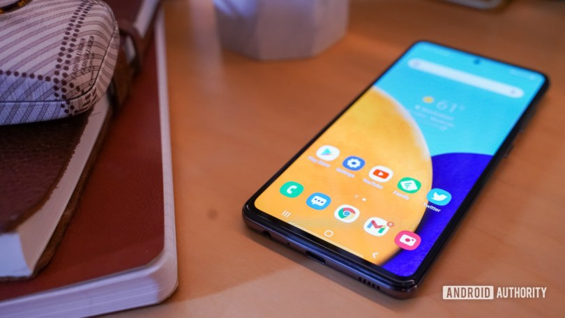 Samsung Galaxy A 52 5G on table with things