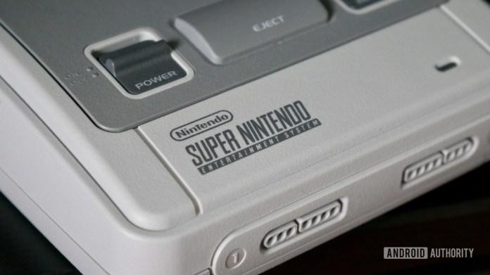 super nintendo snes console showing a closeup of the logo