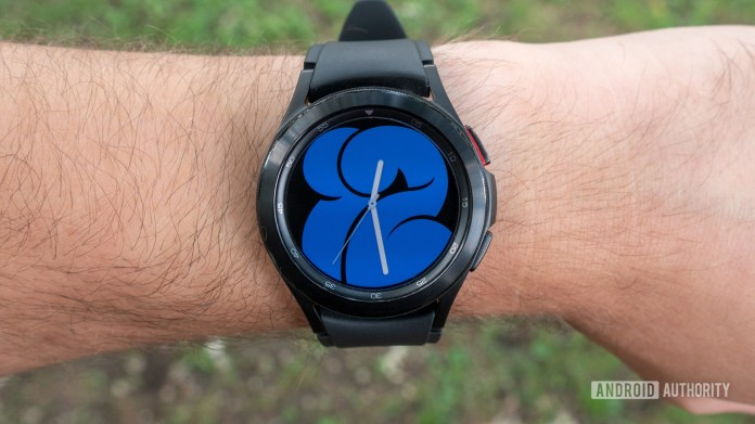 The Samsung Galaxy Watch 4 Classic on a wrist showing the watch face.