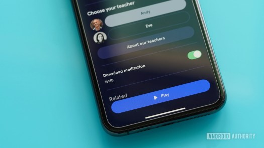 An iPhone 11 on a teal table displays how to download Headspace content for offline listening.