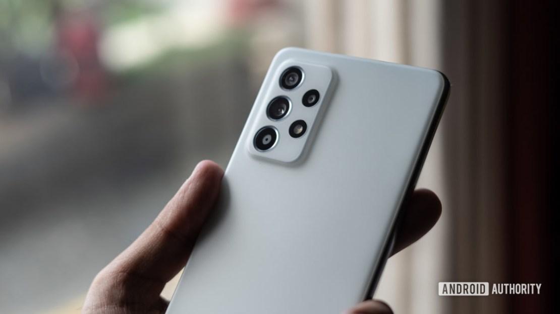Samsung Galaxy A52s 5G camera module in hand