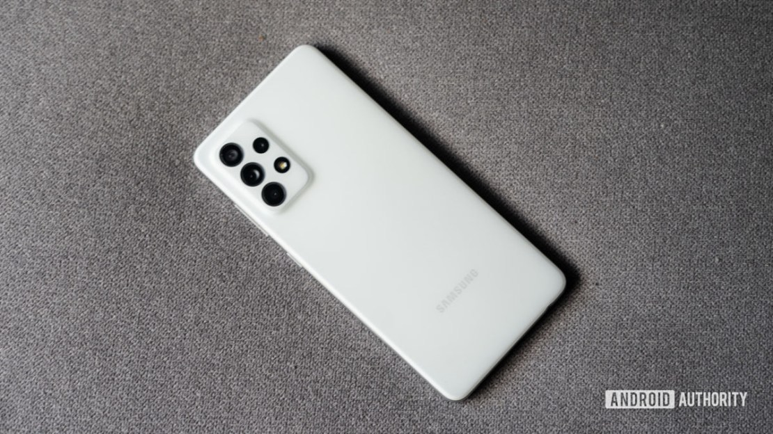 Samsung Galaxy A52s 5G placed on grey fabric showing back panel top down view