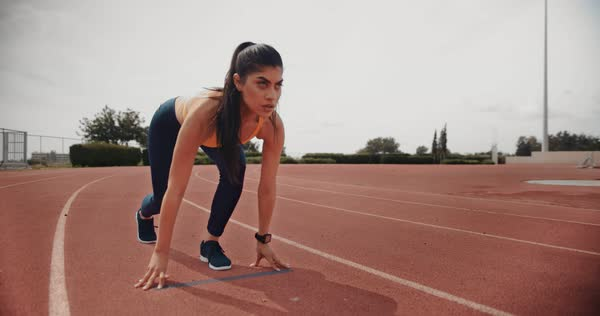 Young female professional runner at starting line ready to sprint - Stock  Video Footage - Dissolve