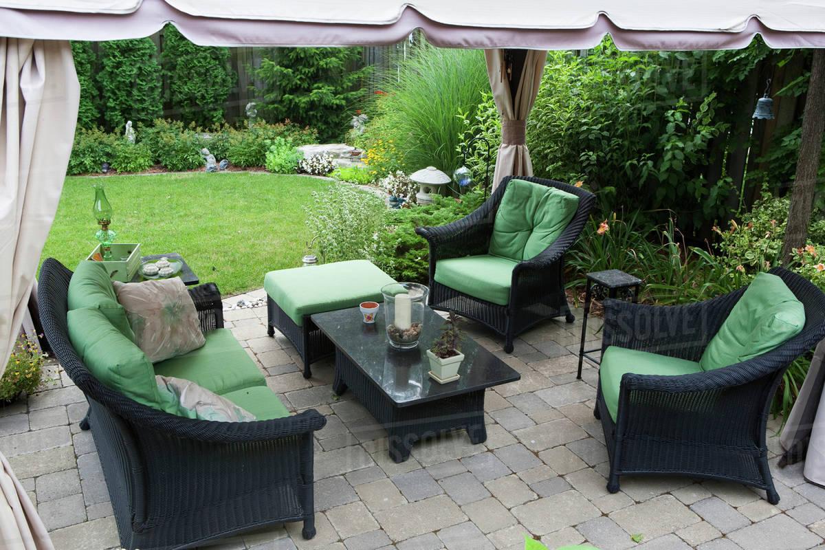 covered patio furniture on stone patio in a backyard burlington d869 35 594