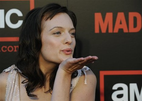 """Mad Men"" cast member Elisabeth Moss blows a kiss to photographers at the Season Two premiere of the AMC television series in Los Angeles"