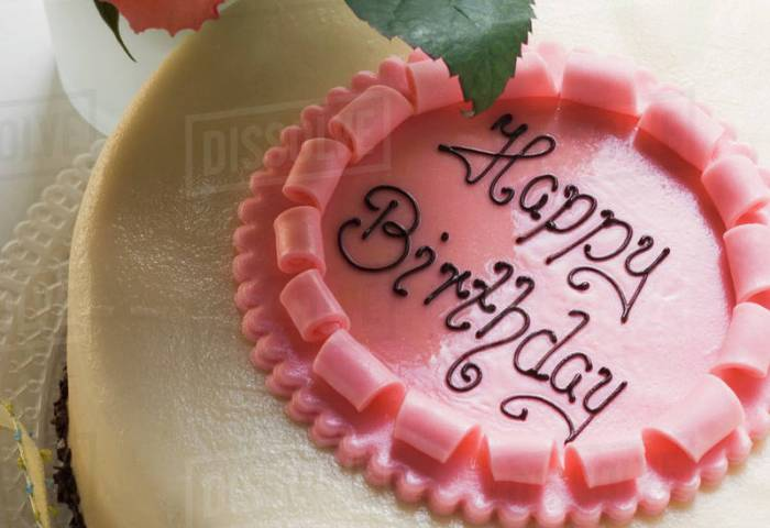 Birthday Cake With The Words Happy Birthday Roses Stock Photo