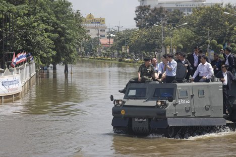 The Prime Minister of Thailand surveying the flooded regions in an armored vehicle