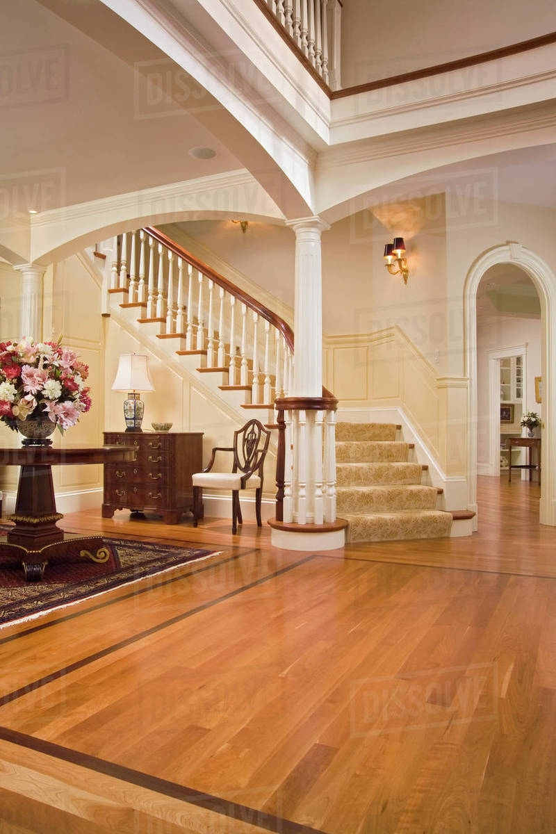 Foyer With Maple Hardwood Floors And Carpeted Staircase Stock | Hardwood Floors With Carpeted Stairs | Wall To Wall Carpet | Painting | Laminate Hall Carpet | Carpet Covered | Carpet Wrapped