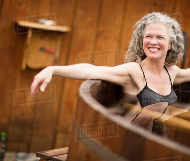 Smiling Mature Woman In Hot Tub At Eco Retreat