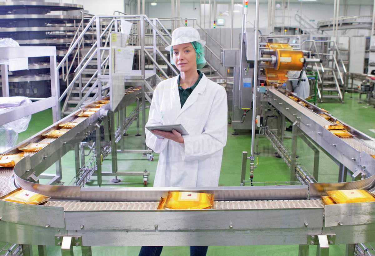 Portrait Quality Control Worker With Digital Tablet At