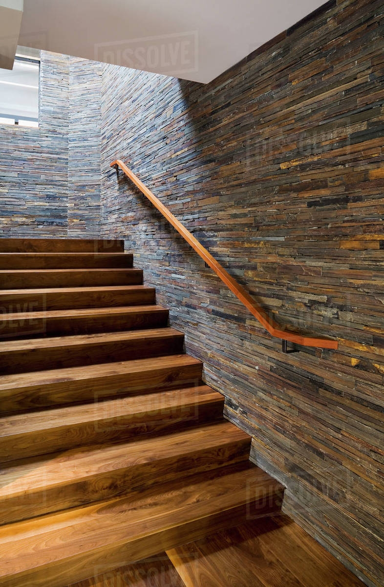 Hardwood Staircase With Stone Tile Wall Stock Photo | Tiles Design For Stairs Wall