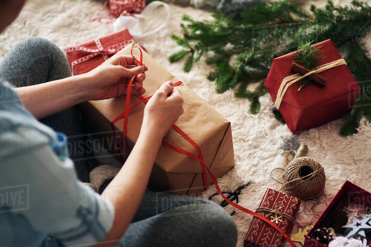 Woman Wrapping Christmas Presents Stock Photo Dissolve