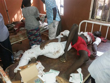 People are treated at the General hospital in Potiskum, Nigeria, Monday, Nov. 10, 2014, following a suicide bomb attack at Government Science Technical College Potiskum.