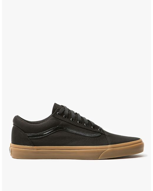 $55 - From Vans, the classic Old Skool shoe in Black. Featuring a canvas upper, padded collar, flat woven laces, metal eyelets, leather side stripe, canvas insole and signature rubber waffle outsole. Old Skool shoe in Black. Canvas upper. Padded collar. Flat woven laces. Metal eyelets. Leather side stripe. Canvas insole. Signature rubber waffle outsole. 1.25
