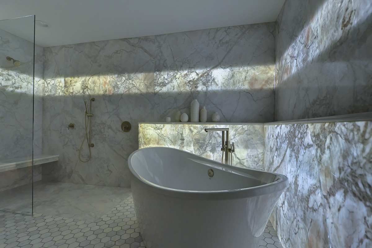 A Backlit Marble Wall Gives This Guest Bath Its Wow