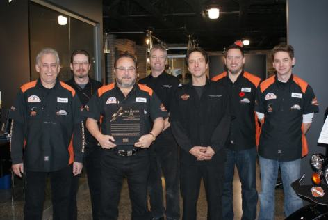Steve and staff with the Special Performance award for Community Service from Deeley Harley-Davidson Canada