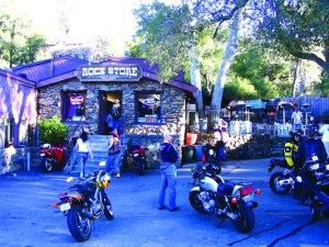 motorcycles parked in front to the Rock Shop