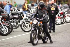 vintage motorcycle meet girl on a black bike