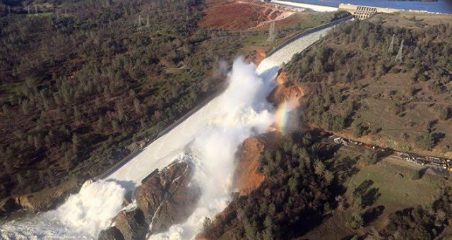 A damaged spillway with eroded hillside is seen in an aerial photo taken over the Oroville Dam in Oroville, California, U.S. February 11, 2017