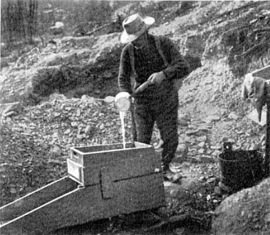 A faster way to pan for gold. The rocker box shakes dirt and gravity separates gold from the soil and water.