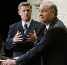 Opposition leader Stephen Harper questions Prime Minister Paul Martin during a 2004 election debate. Although Martin won this round, the Sponsorship Scandal (http://www.cbc.ca/news2/background/groupaction/) led to his downfall. His minority government was defeated in 2006 by current Prime Minister Harper and the Conservative Party.