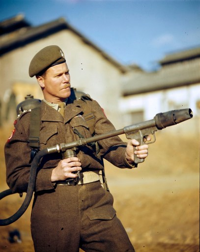 Canadian Soldier poses for the camera, showing the right way to hold a flamethrower.