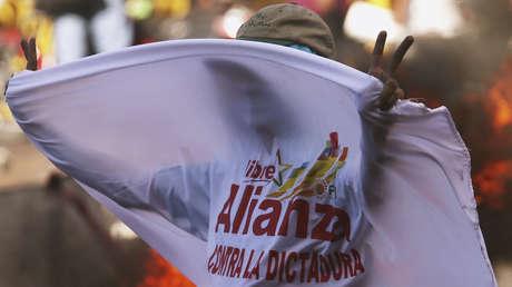 Un simpatizante del candidato presidencial Salvador Nasralla durante una protesta, Tegucigalpa, Honduras.