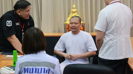 Buddhist monk Wiraphon Sukphon speaking to DSI officials in Bangkok. © Department of Special Investigation