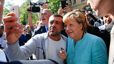 A migrant takes a selfie with German Chancellor Angela Merkel © Fabrizio Bensch