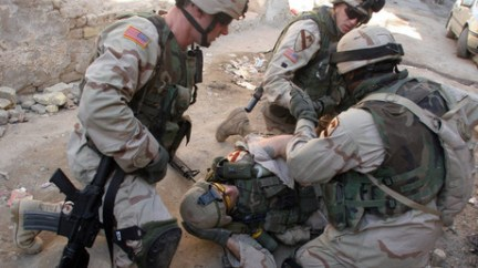 Feb 16, 2005 - Baghdad, Iraq - An American soldier with the 1st Cavalry Division is treated after being shot in the volatile area of the Haifa Street neighborhood. © Robert King