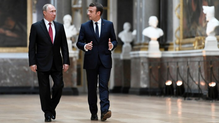 'I'm the equal of Putin,' Macron tells journalists over a drink